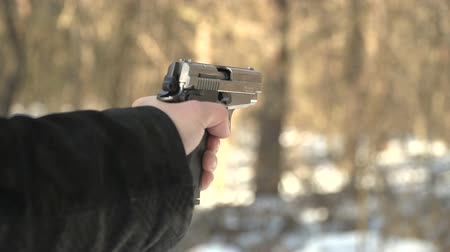 bulletproof : gun shot in slow motion. winter forest landscape