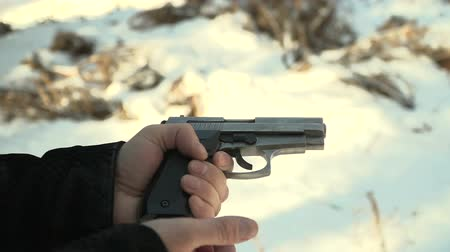 bulletproof : gun reload in slow motion. winter landscape