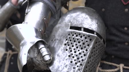 munitions : Knights carry a helmet in his hand Stock Footage