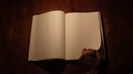 blank : Turning the page of a book on white Stock Footage
