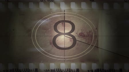 film roll : Movie film with a countdown in sepia tone Stock Footage