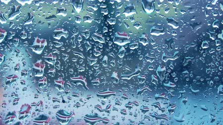 Raindrops falling on the glass