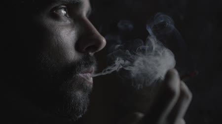 depressant : Portrait of a man smoking in slow motion