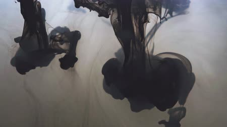 ethereal : Black ink forms in the water