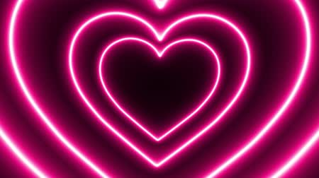 Pink neon heart loop animation on black background Stok Video