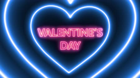 Pink neon text VALENTINES DAY with hearts loop animation on black background