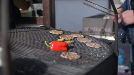méz : People cook barbecue grill, grilled steak, Frying fresh meat, Chicken BBQ, sausage, kebabs, hamburger, picnic with mushrooms and meat Stock mozgókép