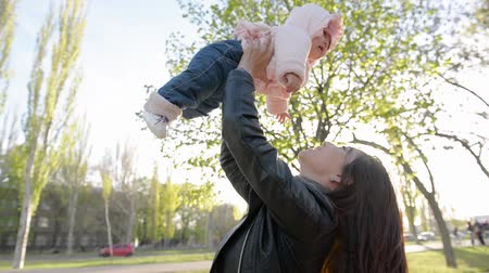 small park : Happy asian mother and daughter spending time together outdoors, , with pleasure in park. Mothers day