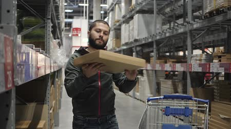 self storage : Handsome man shopping in a supermarket or warehouse
