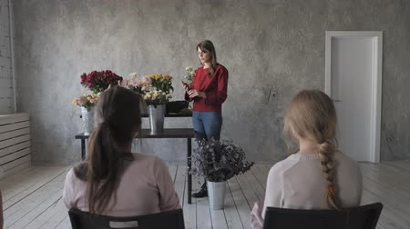 master class : Master class of female florist at work with bunch of flowers. Girl making bouquet of various autumn flowers. Business woman florist at flower shop