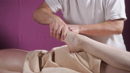 joints : Wellness foot massage. Close up of osteopath doing manipulative massage. Man hands massaging female. Spa centre concept Stock Footage