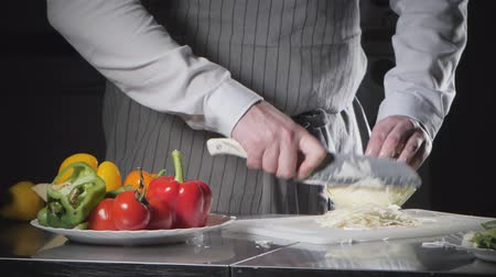 tábua de cortar : Closeup of hand with knife cutting fresh vegetable. Young chef cutting cabbage on a white cutting board closeup. Cooking in a restaurant kitchen Stock Footage