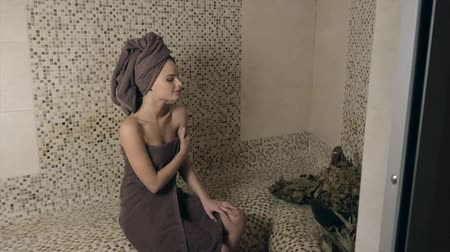 bathhouse : Attractive woman relaxing in a hammam - turkish steam bath with ceramic tile in roman style Stock Footage