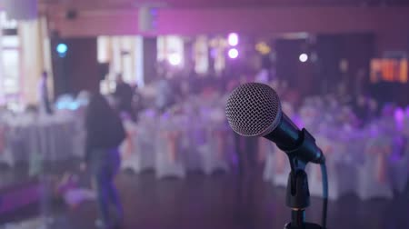 concert hall : Microphone over the Abstract blurred conference hall or wedding banquet background Stock Footage