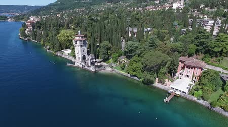 марина : castle. Panorama of the gorgeous Lake Garda surrounded by mountains, Italy. video shooting with drone