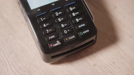 debit : Close-up. Moment of payment with a credit card through terminal. Buy and sell. Products service