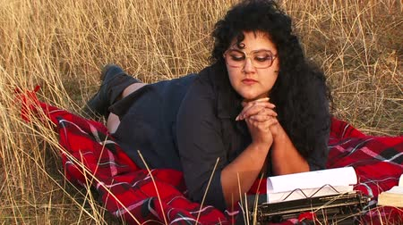maszyna do pisania : Writer typing a book in a field Wideo
