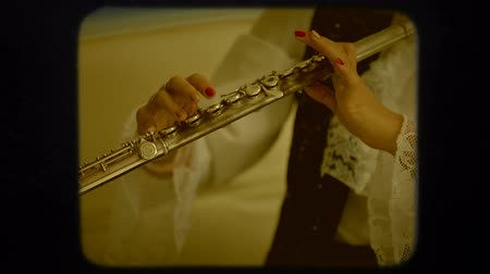 flutist : Woman is professionally playing the flute.