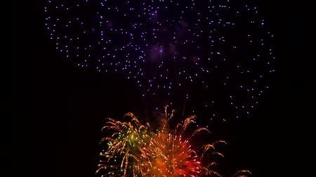 Explosions of multi-colored fireworks balls in the sky
