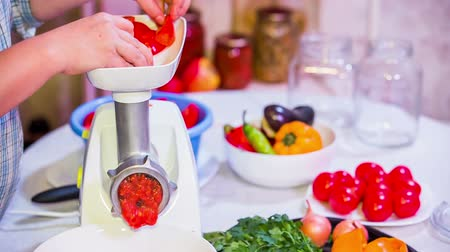 Preparation of tomato paste on grinder