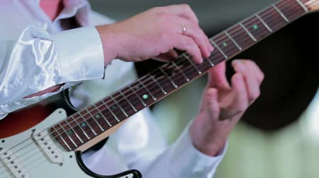 man fingering the fretboard guitar Stok Video