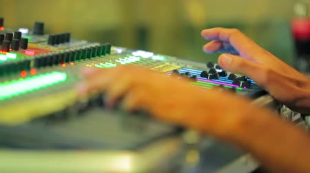 opus : Hands of the sound engineer on the remote control