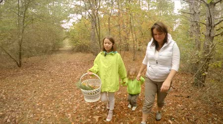 family walks through the autumn forest