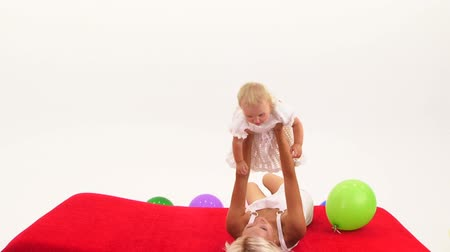 Woman playing with baby girl on floor Stok Video