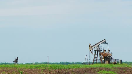 perpetual motion : Several oil-producing towers in the field
