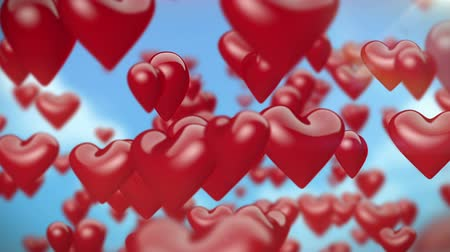 heart shaped : Heart-Shaped Balloons Flying Stock Footage