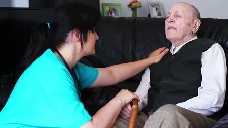 guy home : Senior man talking with nurse