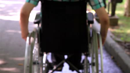 rokkant : Close up of a young man in a wheelchair in the park