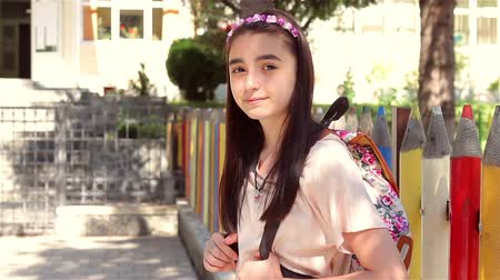 okula geri : Back to school - beautiful young schoolgirl in front of the school, education concept.