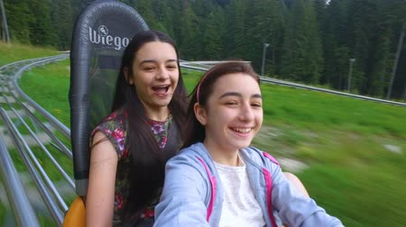 phenomen : Teenage girls having extreme sport activity with bobsled in the pure nature on a sunny day. Stock Footage