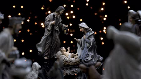 Nativity scene Christmas manger with figures and atmospheric lights. Dolly shot in 4k. Stock mozgókép