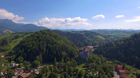 Aerial drone shot of medieval castle in the mountains. Touristic destination attraction in summer. Stock mozgókép
