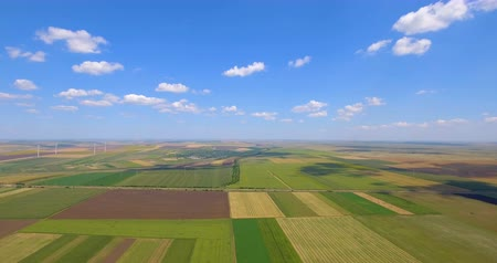 Agricultural parcels of different crops in yellow and green colors. Aerial view shoot from drone dir...