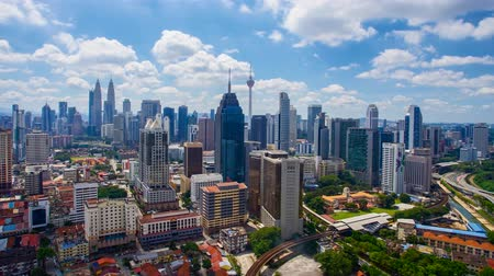 4K Timelapse of Kuala Lumpur skyscapper landscape view during sunny day with dramatic deep blue sky