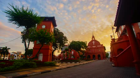 4K Timelapse of Historical red building in Malacca during sunrise 影像素材