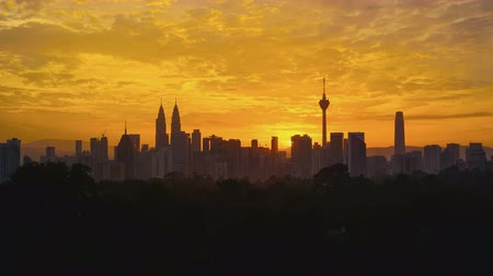 sunset city : 4K Timelapse of Kuala Lumpur city skyline during sunset Stock Footage