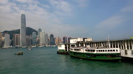 icc : Time-lapse video of the Star Ferry terminal as seen from Avenue of Stars. International Commerce Center (ICC) building and Hong Kong island can be seen in the background.