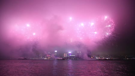 feliz ano novo : Fireworks along Victoria Harbor in Hong Kong, China