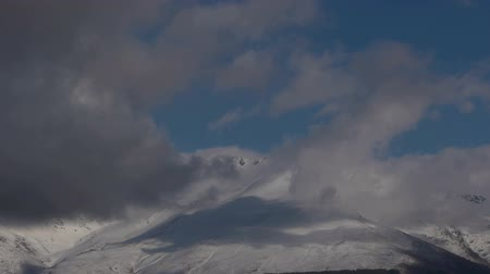 montanhismo : timeslapse in the snowy mountains, with cloudy blue sky, Sierra Nevada, Spain Stock Footage