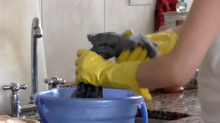 pokojowka : Cleaning Duties. Woman washing a wrap with gloves Wideo
