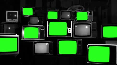 sepia : Many Tvs With Green Screens. Black and White Tone. Aesthetics of the 80s. Ready to Replace Green Screens with Any Footage or Picture you Want.