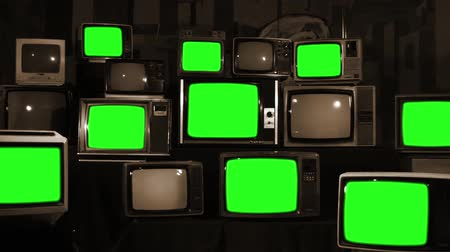 television set : Many Tvs With Green Screens. Sepia Tone. Aesthetics of the 80s. Ready to Replace Green Screens with Any Footage or Picture you Want.