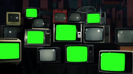 tuşları : Many Tvs With Green Screens. Aesthetics of the 80s. Ready to Replace Green Screens with Any Footage or Picture you Want.