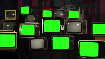 sepia : Many Tvs With Green Screens. Aesthetics of the 80s. Ready to Replace Green Screens with Any Footage or Picture you Want.