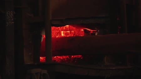 metallurgic : Machine Forging an Iron Block in the Foundry.