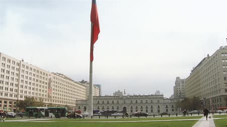 La Moneda Palace And Chilean Flag, In Santiago De Chile.